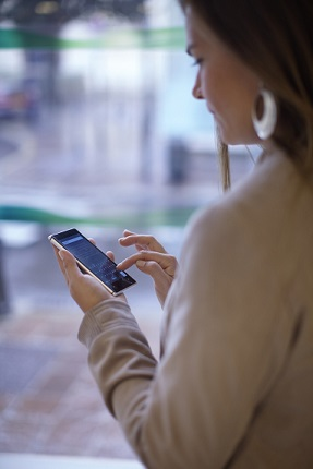 Woman using smartphone on street_