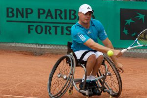 Wheelchair tennis player during a tennis event with BNP Paribas Fortis